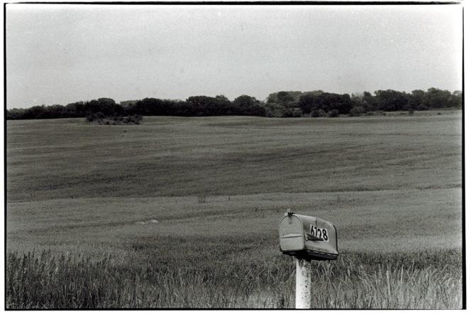 black and white photo of mailbox